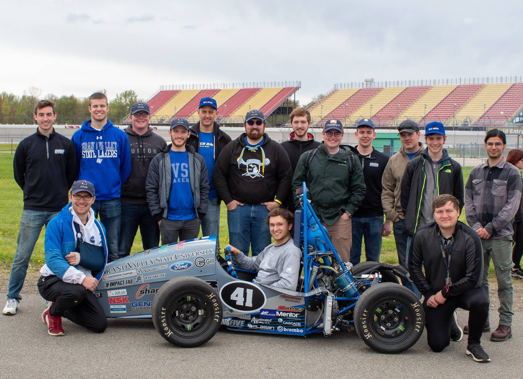 Team in front of SAE Formula one car